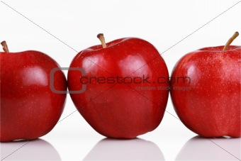 Three shiny red apples