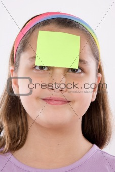 Adorable girl with post-it in her front