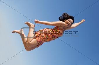Beautiful girl flying
