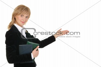 Portrait of businesswoman  pointing at wall .