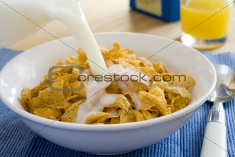 pouring milk into cereal bowl