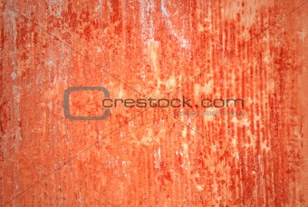 Grungy red wall with lots of streaks