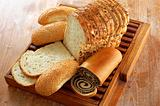 assortment of baked bread and other bakery products