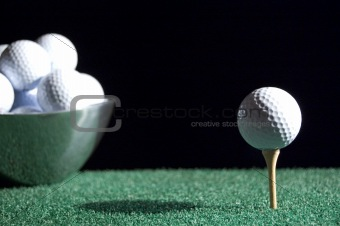 Bowl of Golfballs and Tee