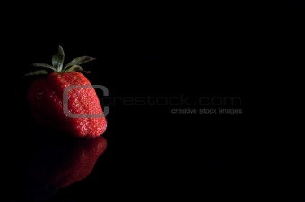One Strawberry on Glass