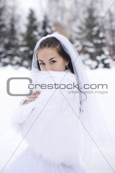 Bride is in the winter forest