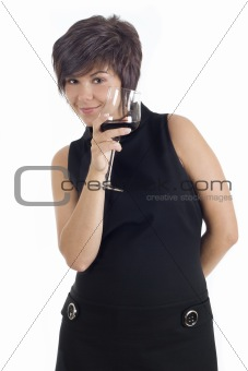 Beautiful girl holding glass of red wine