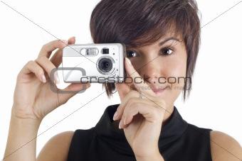 Beautiful girl holding digital camera
