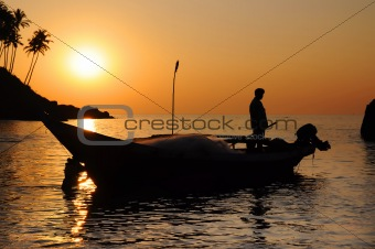 Fisherman with nets on his boat