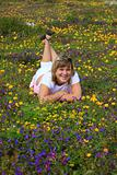 Young girl enjoying on a flowers meadow