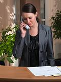 Attractive business woman having a call