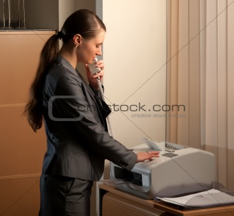 business woman sending fax