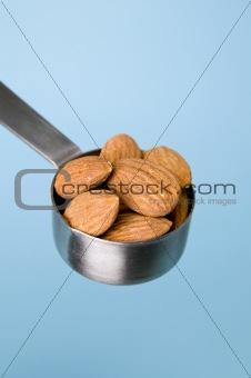 Almonds with blue background
