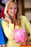 Shopping woman saving money