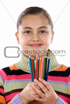 Adorable girl with many crayons of colors