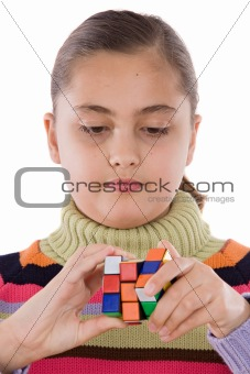 Little girl playing with a colorfull cube