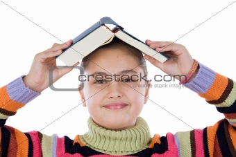 Adorable girl with a book on the head
