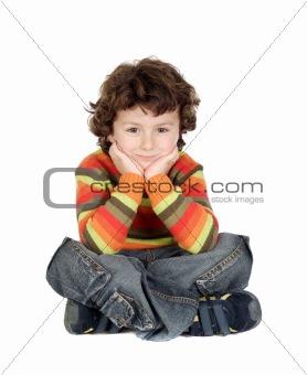 Adorable caucasian boy sitting