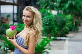 Blonde with coconut in hands