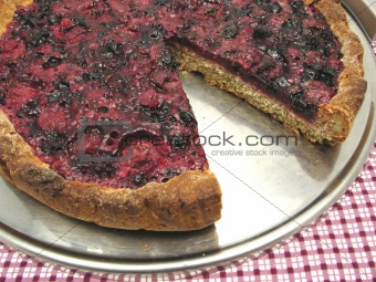 Cutted berry cake on a cake tray