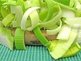 SLiced green leek on a wooden plate