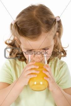 Little girl drinking fruit juice