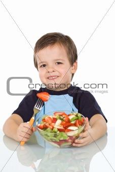 Boy with fruit salad