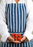 Woman chef with strawberries