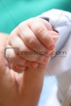 Baby's hand gripping for mothers finger