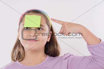 Adorable girl squint with post-it
