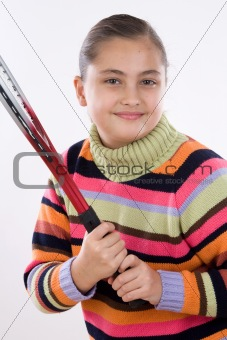 Adorable girl with racket of tennis