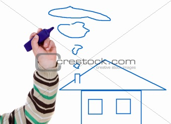Adorable boy drawing a house