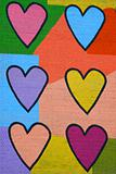 Colorful graffiti spray painted funny hearts on the decorated  b