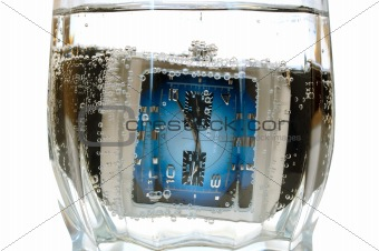 Waterproof (water-resistant) watch in glass with water.