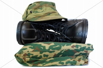 Camouflage uniform and two army boots.