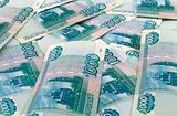 Russian one thousand roubles bills scattered as background