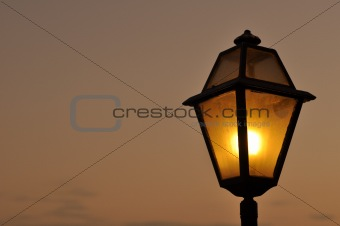 a street light in the sunset
