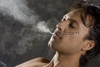 intensively smoking man