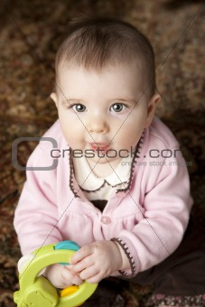 6 Month Old Baby Playing on Patterned Rug