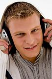 close up view of american man listening to music