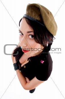 attractive young female with arms crossed and army cap