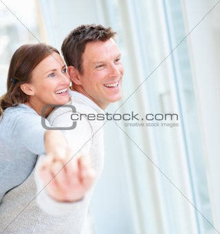 Closeup of a happy young couple hands raised sideways