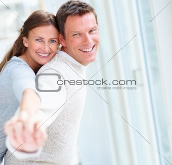 Portrait of smiling young couple enjoying themselves together