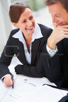 Closeup of happy and cheerful business people enjoying at work