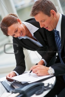 Portrait of smiling confident business colleague working together