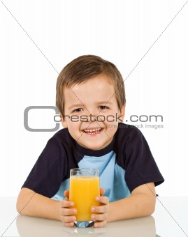 Little boy with a glass of fruit juice