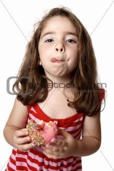 Girl eating doughnut licking lips