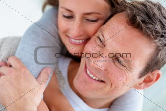 Closeup of a happy young man piggybacking his wife