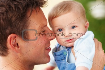 Closeup of a young father with his baby