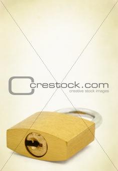 padlock on yellowed background